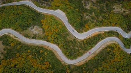 yılantaşı : Aerial view of a traffic driving along a mountain road in Greece Stok Video