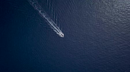 sailing boat : Aerial view of a motor boat sailing the sea fast