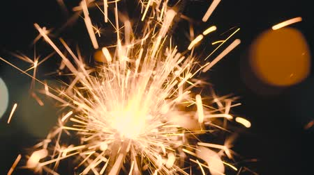 slow shooting : Christmas sparkler burning on a black. Slow motion Stock Footage