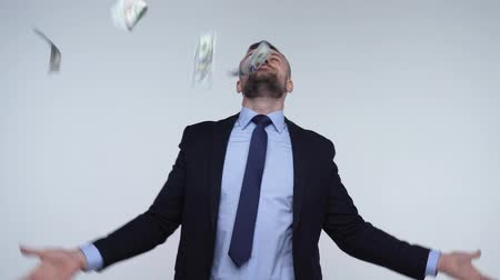 allowance : Man is smelling, throws and enjoys the falling dollar bills. Slow motion Stock Footage