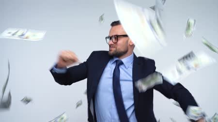 allowance : Dollars falling on formally dressed man Stock Footage