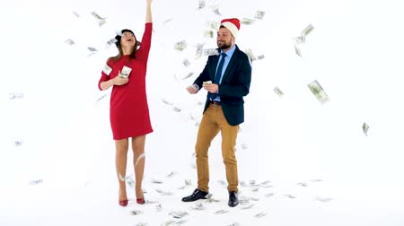 lavish : Man and woman received cash bonuses for Christmas, rejoice and throw money. Lets go celebrate concept.