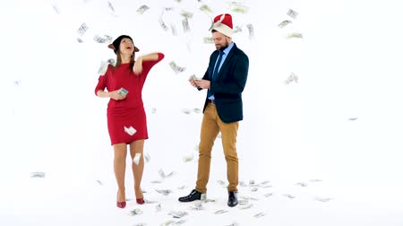зарабатывать : Man and woman received cash bonuses for Christmas, rejoice and throw money. Lets go celebrate concept. Slow motion Стоковые видеозаписи