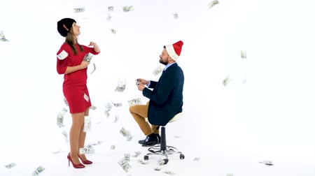 lavish : Man and woman received cash bonuses for Christmas, rejoice and throw money. Lets go celebrate concept. Slow motion Stock Footage
