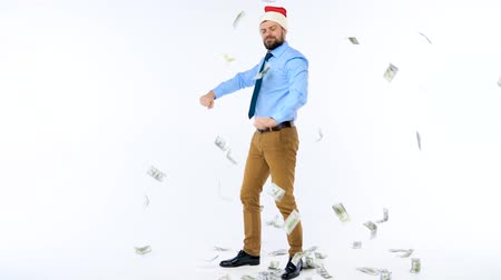 speculate : Slow motion of dollars falling on formally dressed man in the Santa Claus hat