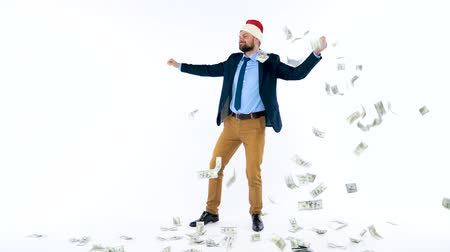 allowance : Dollars falling on formally dressed man in the Santa Claus hat