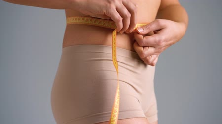 sports nutrition : Healthy waist with measuring tape