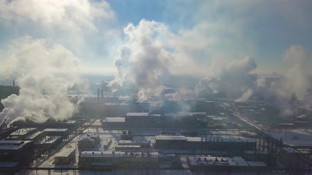 reactor : Aerial view of factory smoke stack - Oil refinery, petrochemical or chemical plant in winter Stock Footage