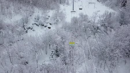 karpaty : Aerial view of ski resort - ski lift and snow-covered coniferous forest. Carpathians, Ukraine