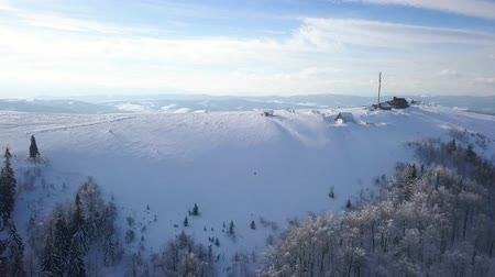 ukraine : Flight over the research station on top of Carpathian mountains covered with snow. Clear frosty weather Stock Footage
