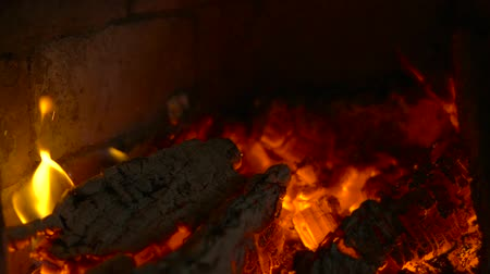 aglow : Smouldering coals in a fireplace. Slow motion Stock Footage