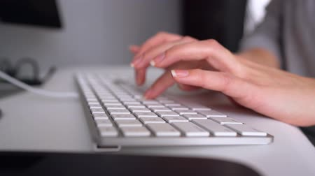 inputting : Woman office worker typing on the keyboard Stock Footage