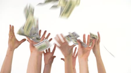 lavish : Many hands catch falling US dollars Stock Footage