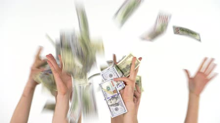 allowance : Many hands catch falling US dollars Stock Footage