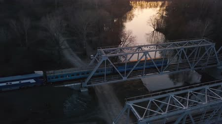 water rail : View from the height of the railway bridge on which the train is passing at sunset