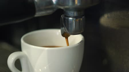 overfill : Coffee machine pouring espresso in cup