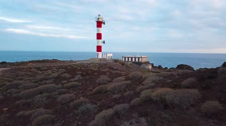 наблюдения : View from the height of the lighthouse Faro de Rasca on The Tenerife, Canary Islands, Spain. Wild Coast of the Atlantic Ocean. Shooted at different speeds: normal and fast