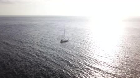 hajózik : View from the height of the yacht near the coast of Tenerife, Canary Islands, Spain at sunset