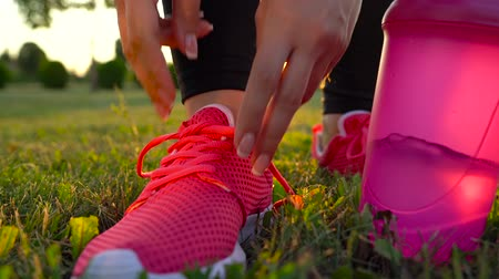 shaker : Running shoes - woman tying shoe laces Stock Footage