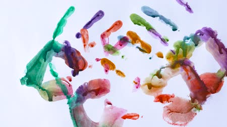 otisk : Creative concept - man and woman make prints of their painted hands on a white background