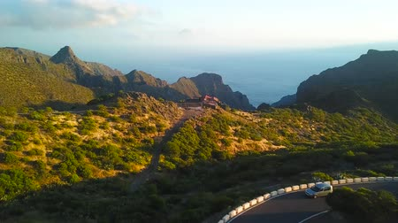 yılantaşı : View from the height of the rocks, winding road and ocean in the distance in the Masca at sunset, Tenerife, Canary Islands, Spain.