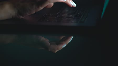 inputting : Hands or woman office worker typing on the keyboard at night