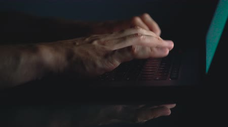 inputting : Hands or man office worker typing on the keyboard at night