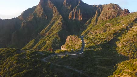 yılantaşı : View from the height of the rocks and winding road in the Masca at sunset, Tenerife, Canary Islands, Spain.