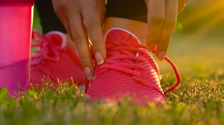 shaker : Running shoes - woman tying shoe laces. Slow motion