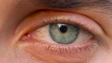 nervous : Beautiful blinking male eye close-up Stock Footage