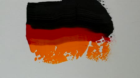 Creating a flag of Germany with acrylic paints and palette knife