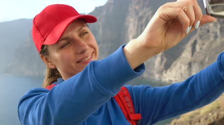 sziget : Woman makes a self photo of Los Gigantes Cliffs on Tenerife, Canary Islands, Spain