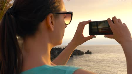 sabah : Woman taking pictures of the sunset on the promenade, Tenerife, Canary Islands, Spain