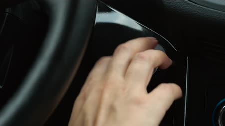 fülke : Close up of female finger pressing an engine start stop button in car
