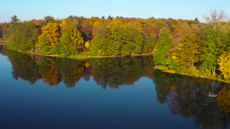rosário : Aerial view of the lake and the bright autumn forest on its shore. Forest is reflected on the surface of the lake