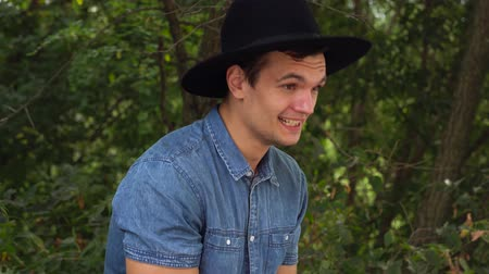 modelka : Young hipster man in hat laughing, relaxed in front of the camera Wideo