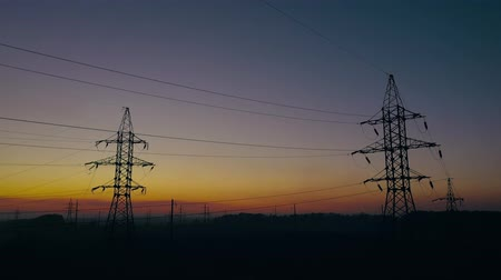 energia : View from the height of power line silhouettes against sunset sky