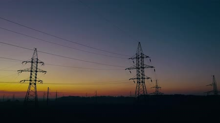 voltů : View from the height of power line silhouettes against sunset sky