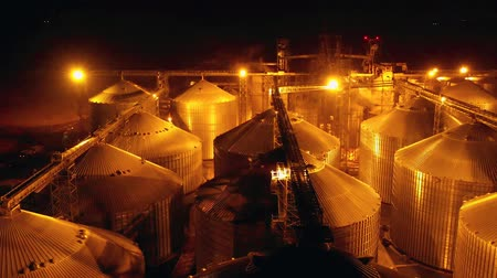 torre : Flight under granaries and elevators or oil storage. Hyperlapse Stock Footage