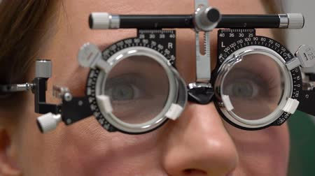 refractive : Woman at the reception of an ophthalmologist. Eye examination and selection of spectacle lenses Stock Footage