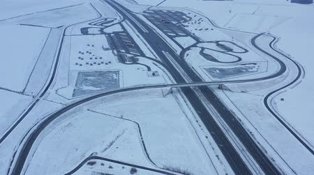 trilhas : Aerial view of a highway in Poland in winter Vídeos
