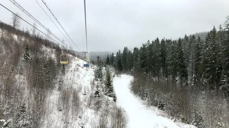 narciarz : View from the chair to the chair lift at a ski resort in winter. Wideo