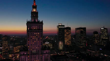stalinist : Aerial view of the business center of Warsaw: Palace of Science and Culture and skyscrapers in the evening