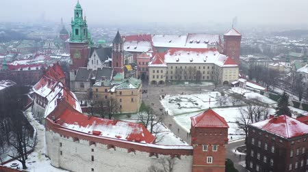 wawel : Aerial view of Wawel royal Castle and Cathedral, Vistula River, park, promenade and walking people in winter. Poland Stock Footage