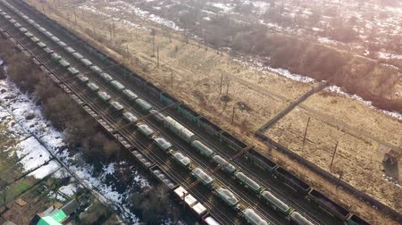 natura : View from the height on long container freight train transporting goods across the country