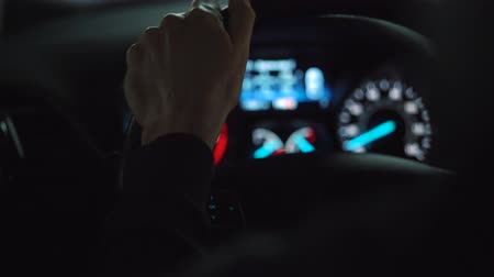vista lateral : Close-up view of the male hands on the steering wheel driving the car Stock Footage