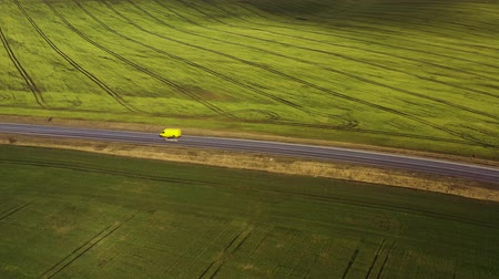 plain : Top view of a cars driving along a rural road between two fields
