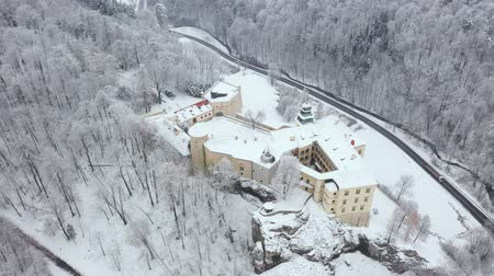 torre : Aerial view oh historic renaissance castle Pieskowa Skala near Krakow in Poland in winter. Filmed at various speeds: normal and accelerated Stock Footage