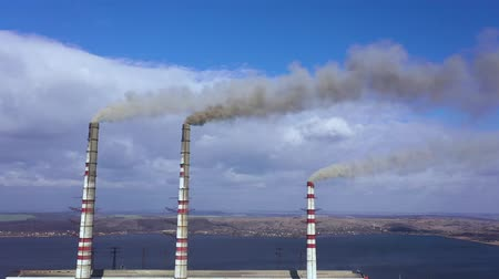 energia : Aerial view of old thermoelectric plant with big chimneys in a rural landscape near the reservoir