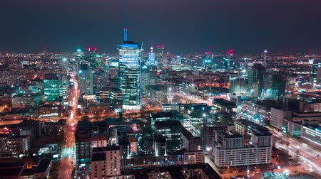 semt : Aerial hyper lapse of Warsaw business center at night: skyscrapers and Palace of Science and Culture